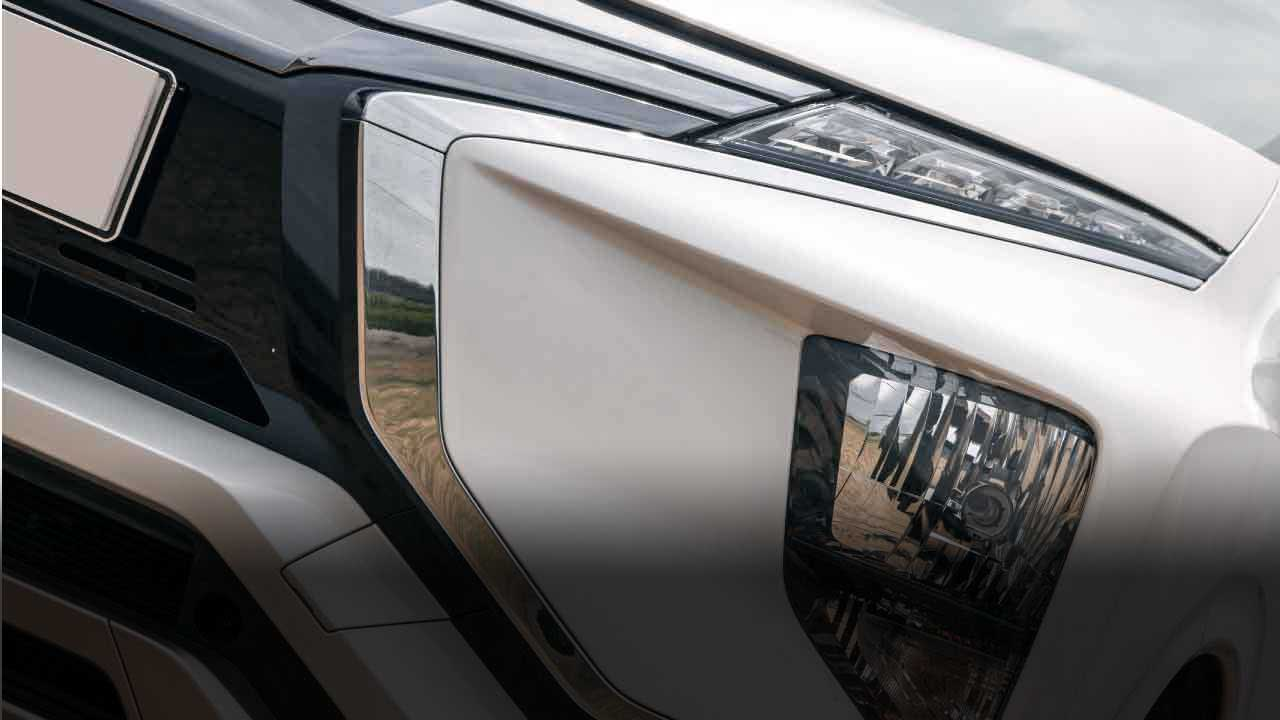 Lower position of headlamps